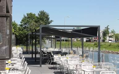 Retractable dual motor patio deck cover system