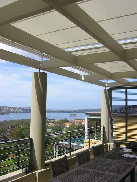 retractable cover above pergola
