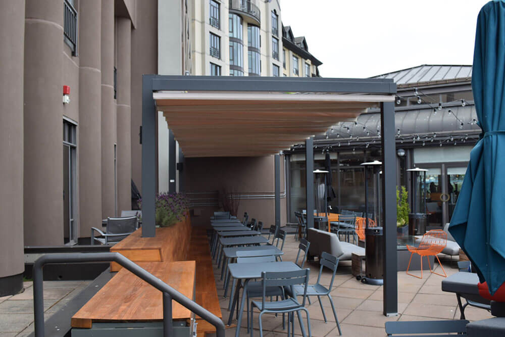 delta hotel forli model freestanding retractable deck patio pergola cover system
