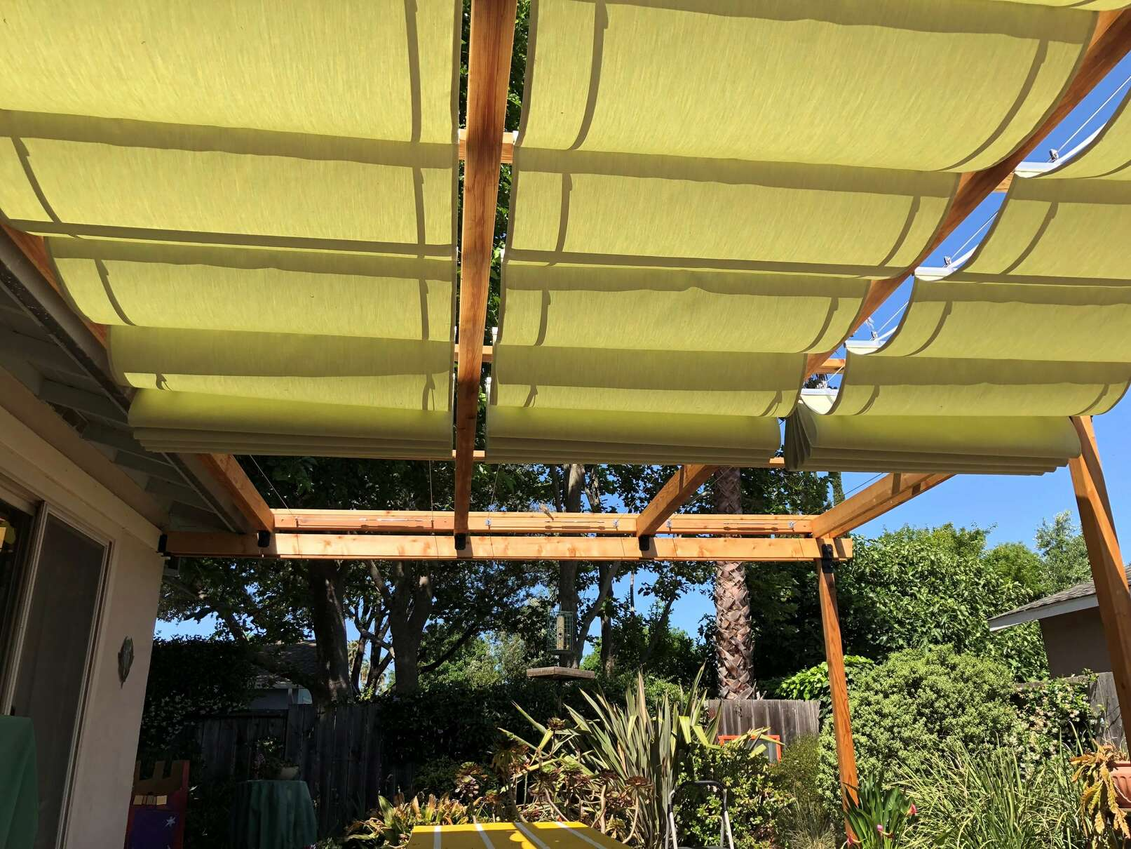 retractable guide wire slide on wire sun canopy
